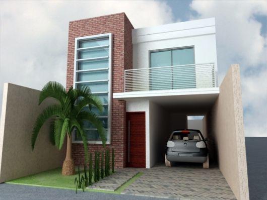 sobrado com janela ampla, decoração de tijolo à vista e jardim com palmeira