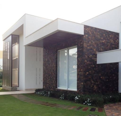 Fotos de pedra ferro em fachadas e muros