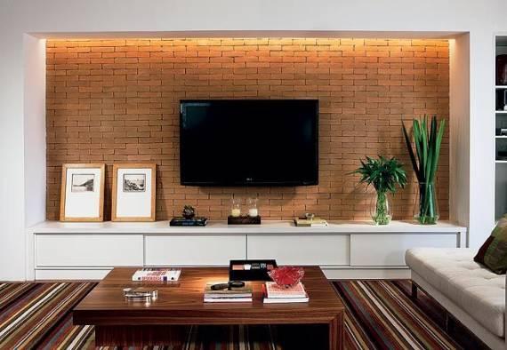 painel de TV feito de tijolo a vista