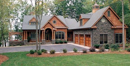 casa rústica com tijolos aparentes e parede de pedra