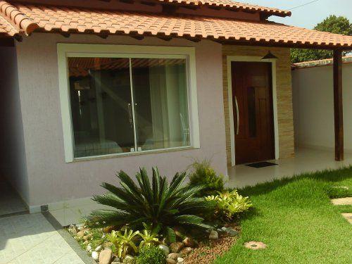 casa pequena quadrada com telhado aparente