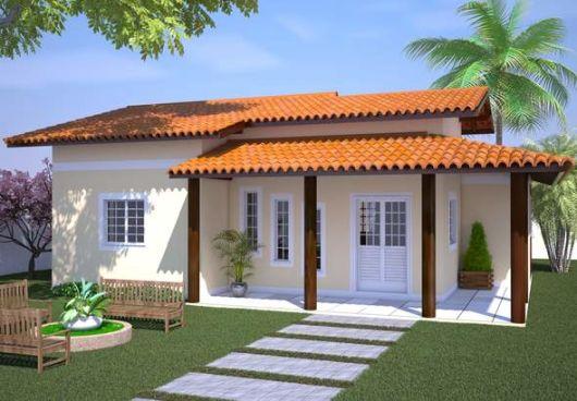 casa com varanda decorada com bancos no jardim