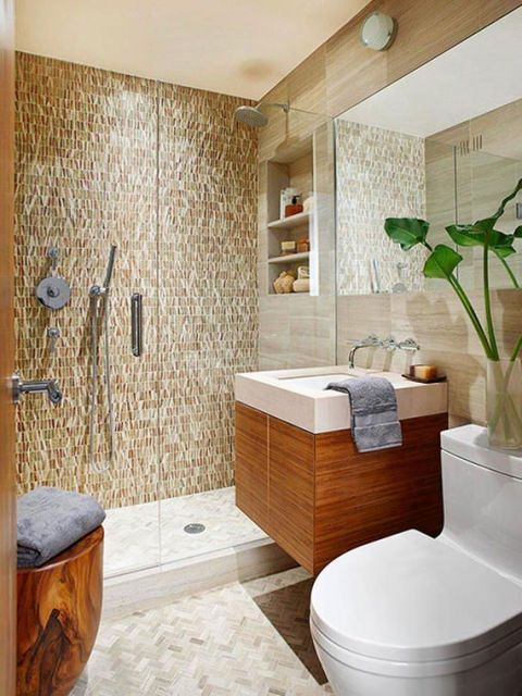 banheiro com pia de madeira e decoração com plantas