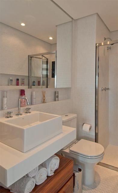 como deixar toalhas expostas banheiro