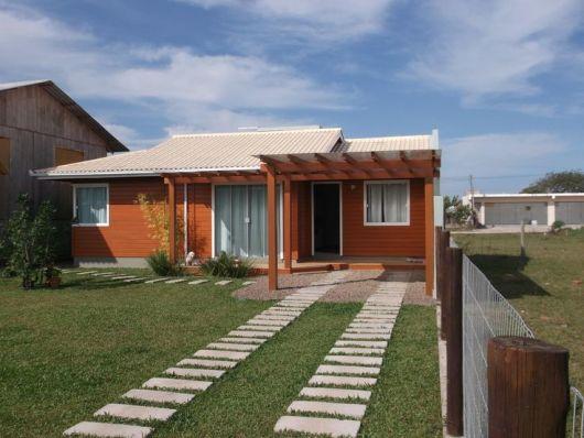 80 casas de madeira projetos modelos fotos e dicas for Casa moderna 100m2