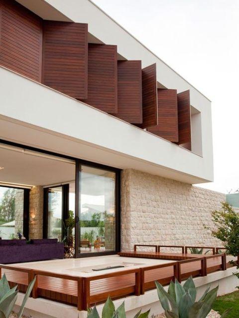 fachada com decoração madeira