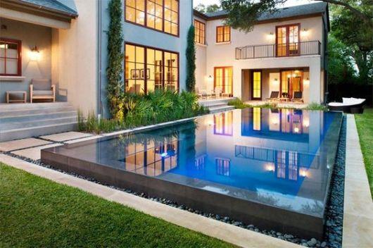 casa linda com piscina borda infinita