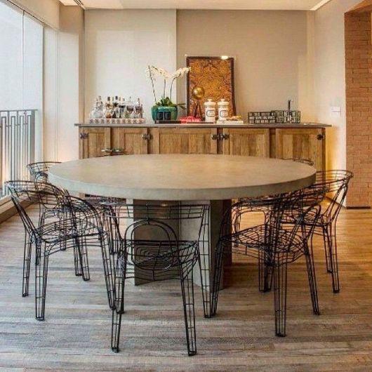 fotos de mesa de jantar redonda de concreto