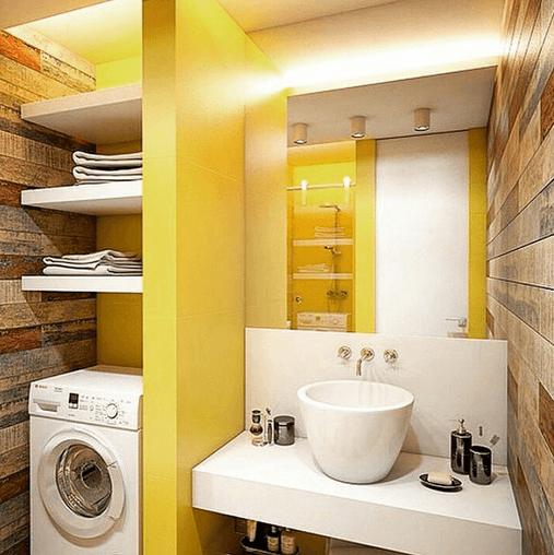 Banheiro moderno com máquina de lavar