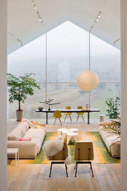 sala com parede de vidro linda