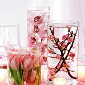 decoração com orquídea em vasos de vidro