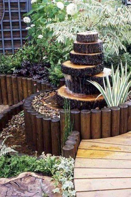 jardim rústico fonte de tronco