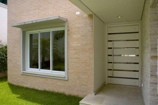 fachada com tijolo a vista