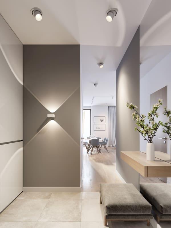 Projeto de hall de entrada com parede fendi iluminada por arandela