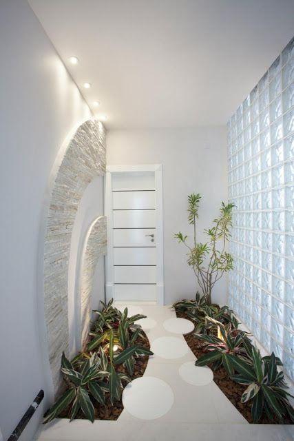 ideias jardim de inverno : ideias jardim de inverno:Uma das paredes é de blocos de vidros