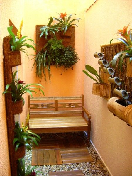 jardim de inverno em quarto de casal com pergolado