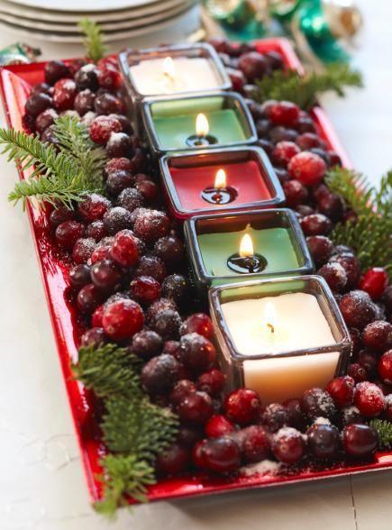 mesa de natal decorada com frutas e velas