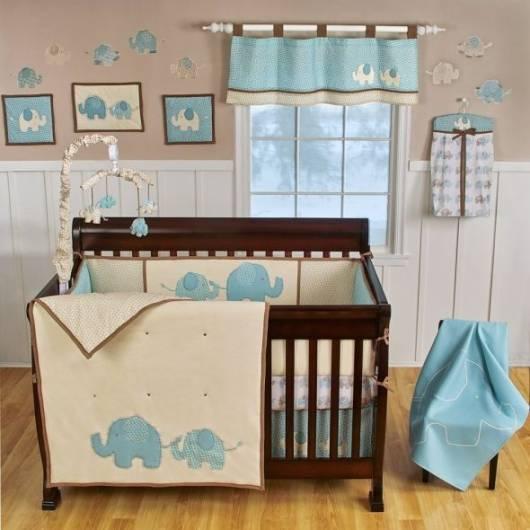 quarto de bebê azul e marrom elefantes