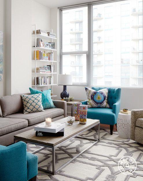 salas com sofá cinza apartamento