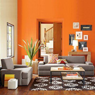 salas com sofá cinza parede laranja