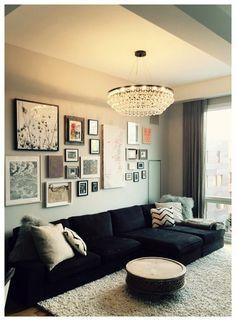 salas com sofá preto decoração neutra