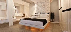 quarto com banheira integrada estilo clean