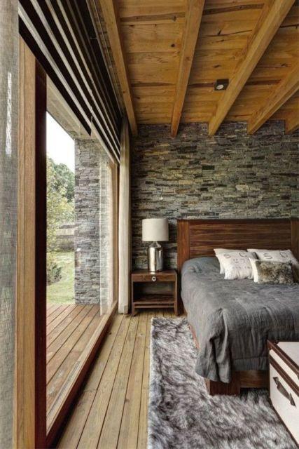 parede de pedra quarto