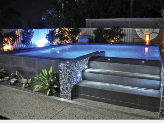 Piscina acima do solo elevada vantagens dicas e 24 modelos for Pintado de piscinas