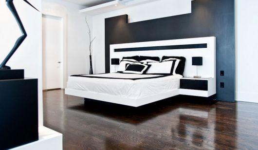 cama flutuante com cabeceira que se alonga até o criado-mudo