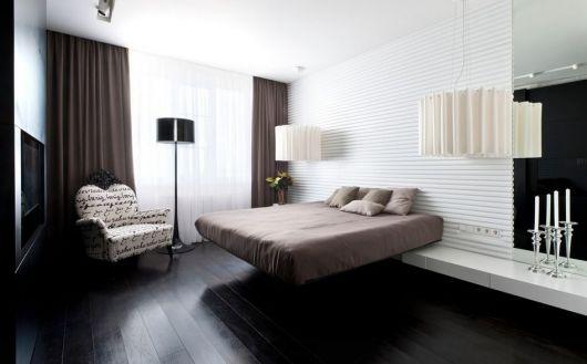 cama flutuante com aparador flutuante ao lado