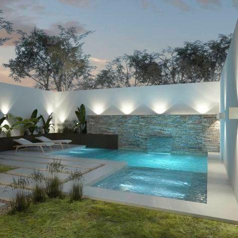 jardim com piscina e muro iluminados