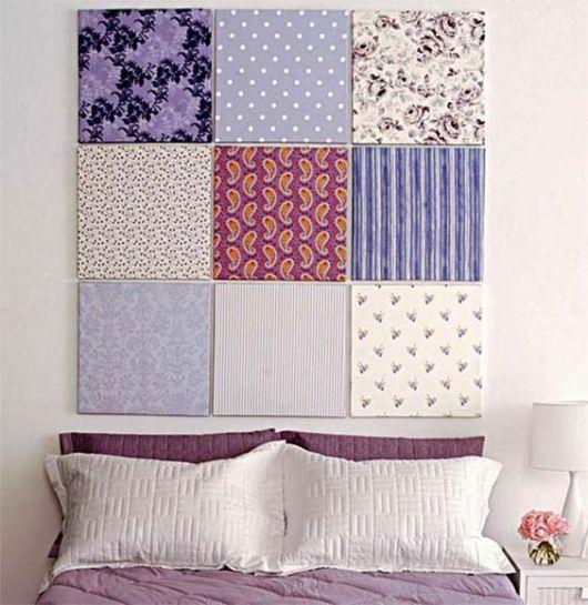 quadros de tecidos sobre cama de casal