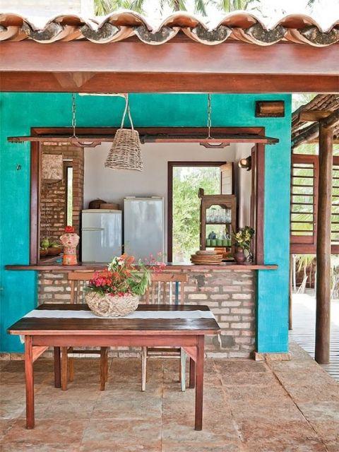 cozinha externa com parede azul
