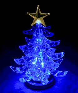 árvore de natal azul muito pequena com uma estrela dourada no topo