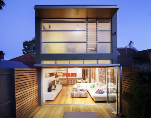 Foto de uma casa com paredes feitas de pallets na varanda do quarto