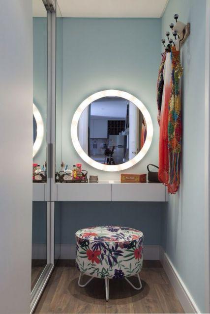 espelho redondo iluminado