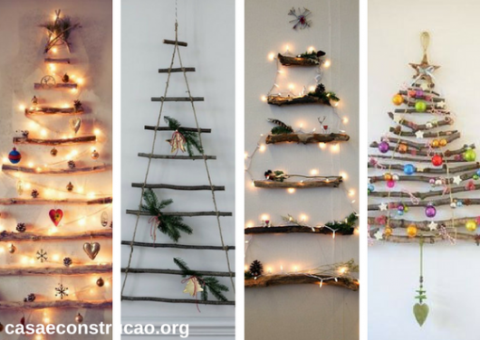 árvores de Natal suspensa na parede feita com tocos de árvore