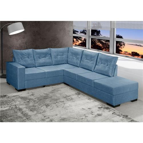 Sala com sofá em L, com tapete e paredes neutras.