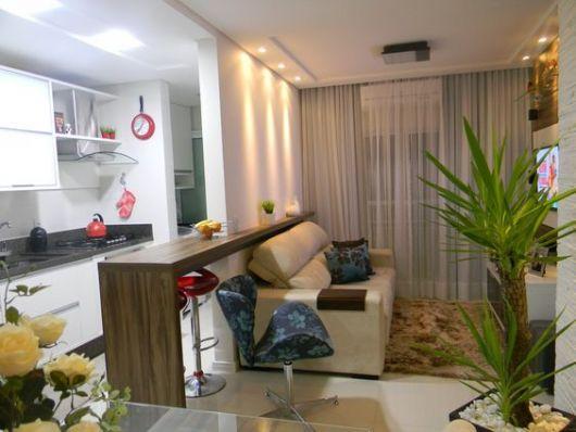 sala simples com cozinha americana de apartamento