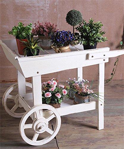 Modelo de carrinho de chá na cor branca com roda, decorado com plantinhas.