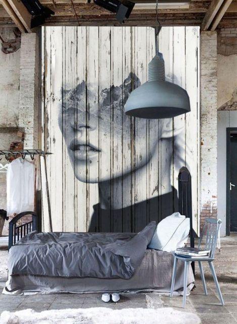 Quarto com cama de solteiro, e painel de mulher ao fundo desconstruído.