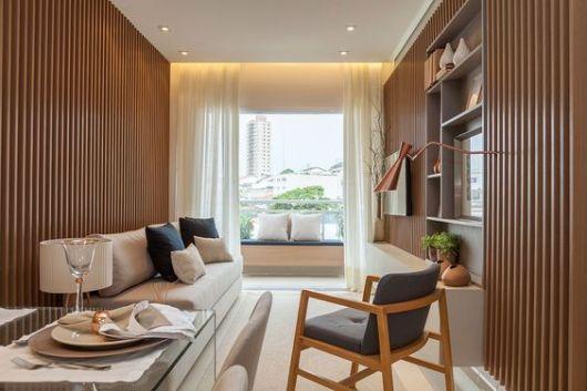 sala apartamento com poltrona
