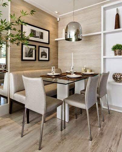 Quadros minimalistas na sala de jantar.