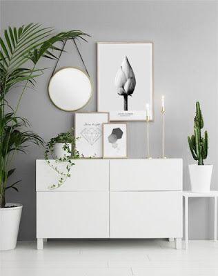 Parede cinza com quadro minimalista.
