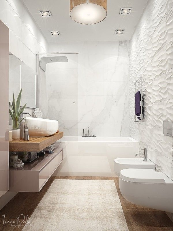 Banheiro moderno com revestimento 3D e lustre redondo