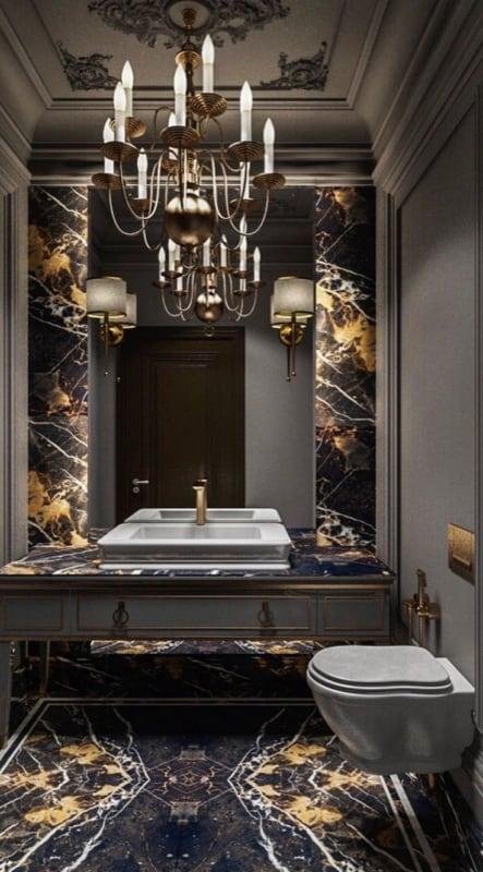 Lavabo luxuoso com mármore e lustre de velas dourado