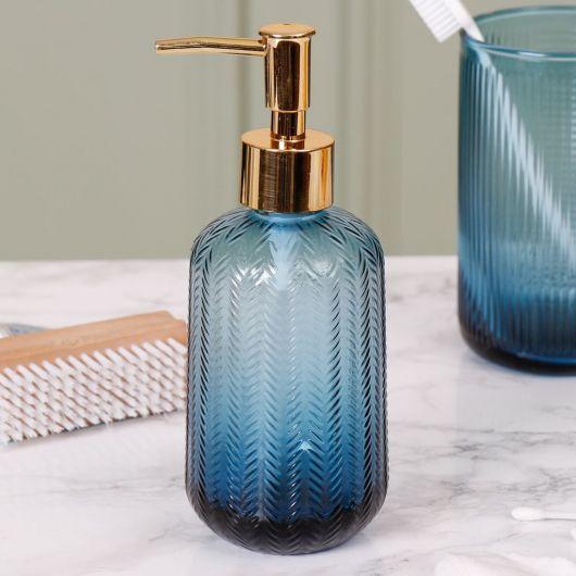 Porta sabonete líquido de vidro azul.