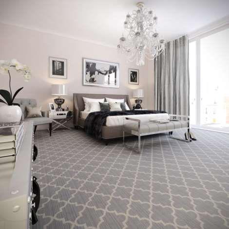 Carpete para quarto escuro decorado com formas geométricas que parecem balões indianos.