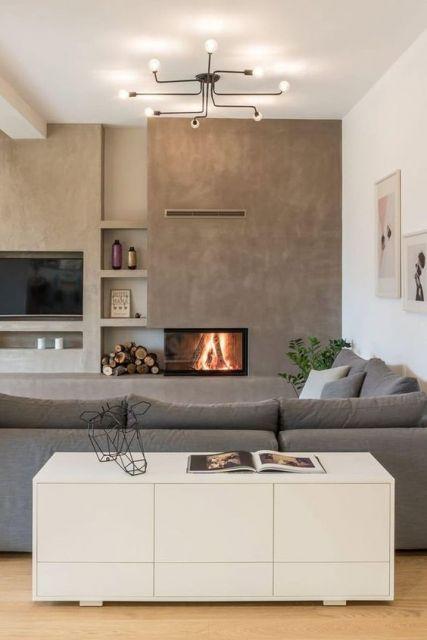 sala com parede de cimento queimado