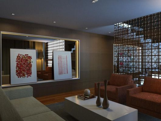 parede vazada em sala com sofá